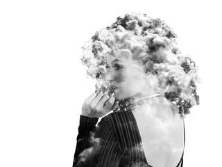 Double exposure of beautiful woman back portrait and cloudscape, monochrome