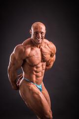 bodybuilder posing in studio
