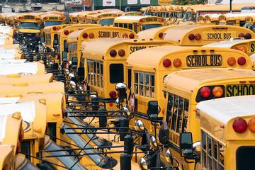 American school buses in bus depot, New York