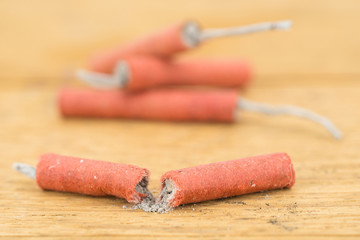Red Firecrackers on wooden background