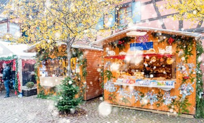 Christmas market under the snow in Eguisheim, Alsace, France