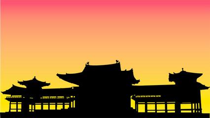 お寺に夕暮れシルエット