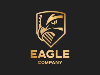 Head of the eagle on the shield - golden logo, mark, emblem on a dark background
