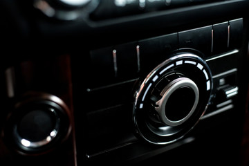 Photo of dashboard of car, Interior View of the modern business car, detail. Closeup fashion image.