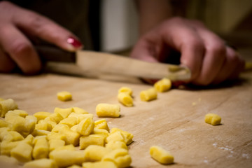 Hands Cutting The Knead Little Pieces With A Knife Preparing An Italian Traditional Food