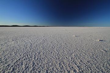 Salt lake under blue sky