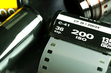 The 35mm reel of film on a dark background
