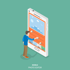 Mobile image editor flat isometric vector concept. Man is editing a picture on the smartphone by applying some filters and changing some other settings.