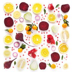 Creative flat layout of fruit, top view. Sliced orange, lemon, beet, tangerine, green leaves isolated on white background. Food wallpaper, composition pattern of fresh fruits and vegetables.