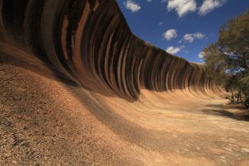 Wave Rock in Hyden, Western Australia. This rock formation looks like a tall breaking ocean wave.