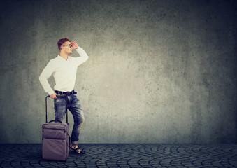 Man with suitcase exploring future