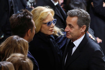 Former French President Nicolas Sarkozy pays his last respects to Johnny Hallyday's first wife, Sylvie Vartan, and son David Hallyday during the funeral ceremony for the late French singer Johnny Hallyday at the Madeleine church in Paris