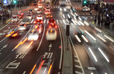 Traffic with blurred lights on the streets of Tokyo illustrating a busy, hurried concept or human population