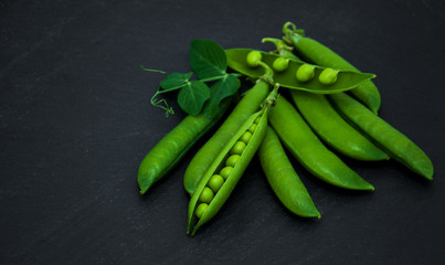 green peas on a stone background