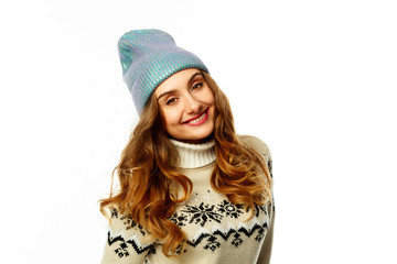 Young happy woman in warm sweater over white background