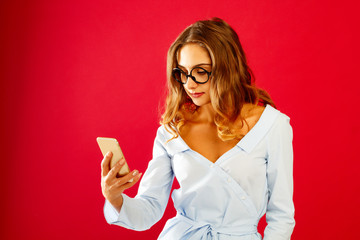 Portrait of a beautiful young woman making selfie on smart phone. Happy young woman photographing herself.