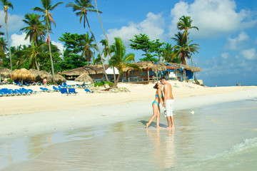 A loving couple on a beach in Punta Cana, Dominican Republic.