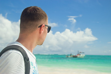 A traveler on the beach in Punta Cana, Dominican Republic.
