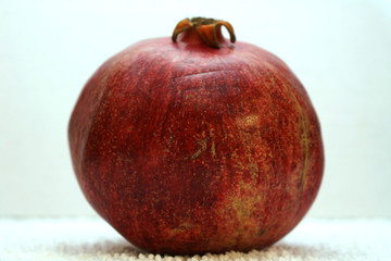 Big ripe red pomegranate. The fruits of red ripe pomegranate on a white background.