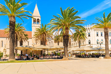TROGIR TOWN, CROATIA - SEP 6, 2017: historical buildings and church in old town of Trogir on sunny summer day, Dalmatia, Croatia.