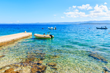 Beautiful beach with boats on sea near Bol town, Brac island, Croatia