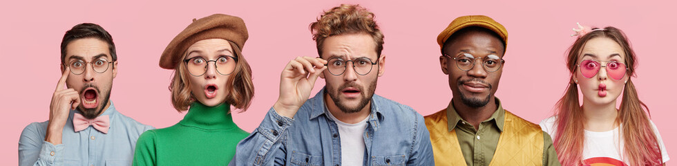 Composition of five different people wear spectacles, look with surprised expression, beig from various nations, express shock and disbelief. Women and men stand in row isolated on pink background