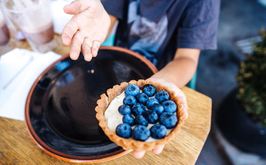Dessert with blueberries in an edible basket