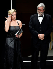 Hungarian actress Alexandra Borbely delivers a speech, next to the Austrian actor Peter Simonischek, after receiving the European Actress 2017 award during the 30th European Film Awards Ceremony in Berlin