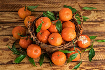 Clementines or mandarins organic fruits on a old wooden background
