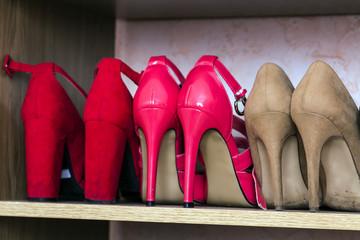 Fashionable high heel women shoes on a shelf