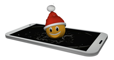 Emoticon with Santa hat jumps into the display of a mobile phone.