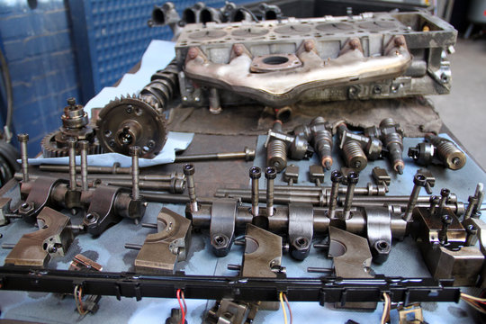 Disassembled five-cylinder car engine for repair in garage