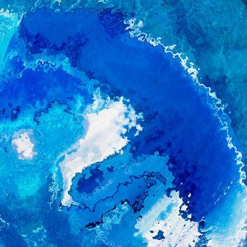 Deep blue oceanic waves splash