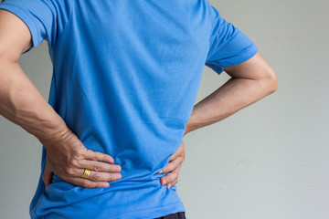 close up shot of asian man with back pain