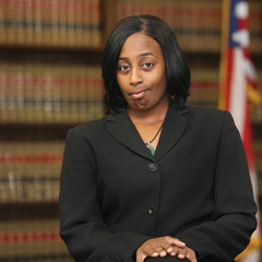 Portrait of a young attractive African America woman. Woman lawyer in law library. Civil Rights lawyer