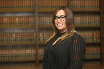 Portrait of young attractive Mexican American woman lawyer, woman professional