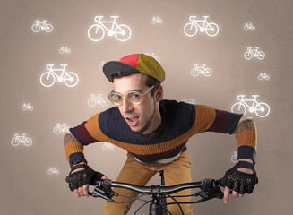 Lunatic cyclist with bike on the background