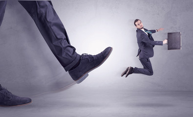 Foot kicking, businessman flying