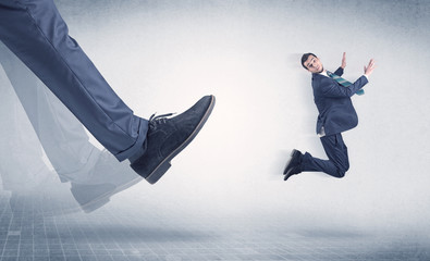 Businessman foot kicking small businessman