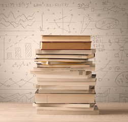 A pile of books with math formulas written in doodle style