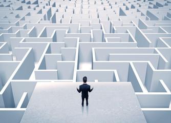 Wall Mural - Businessman staring at infinite maze