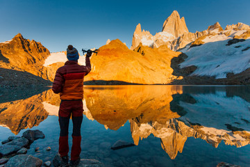 Tourist with drone on a background of mountain landscape. Patagonia Wall mural