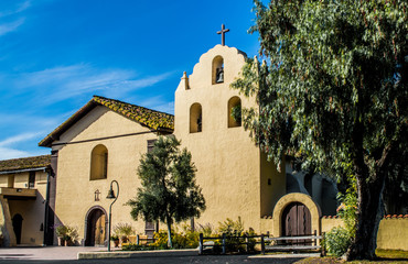 exterior view of Santa Ines mission in California with early morning sunlight