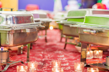 Holiday Party buffet trays all set up before the feast with bunson burners and flames