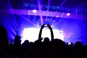 Close up of photographing with smartphone during a concert