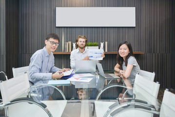 Group of business people meeting in a meeting room, sharing their ideas, Multi ethnic