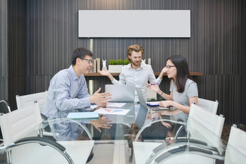 Blonde business man does not understand native language in meeting room