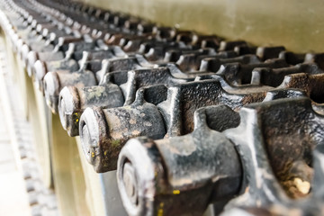 Caterpillar of a military tank or excavator. Close-up photo