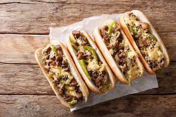 Delicious cheesesteak sandwiches close-up on the table. Horizontal top view