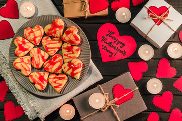 cookie-hearts, paper hearts, candles, boxes with presents, congratulation with Valentine's day.